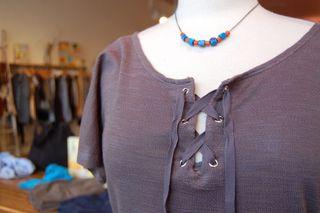 Om girl top, sulu necklace